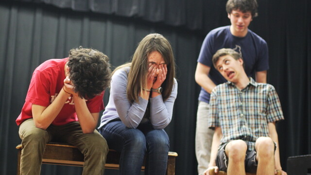 "The Memorial High School Improv Team demonstrates its vast character range, from (left to right) ""distraught man"" to ""distraught woman"" to ""guy standing behind chair"" to ""Stephen Hawking"". These (and other) chops helped to land them a spot at the Chicago Teen Comedy Festival on May 7."