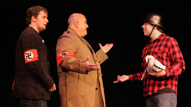 why are two nazis talking to that lumberjack and his pet bird? because it's musical theatre, duh. Chippewa Valley Theatre Guild players in a rehearsal of The Producers.