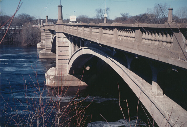 The Madison Bridge in its final days, 1986.  Notice the fancy stone work including turrets.