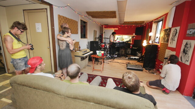 MUSIC IN THE FRONT, MUSIC IN THE BACK. Some folks take in the sweet sounds of Attack, Octopus at the July opening of Wail House 2, a rockin' multi-use space in Altoona.