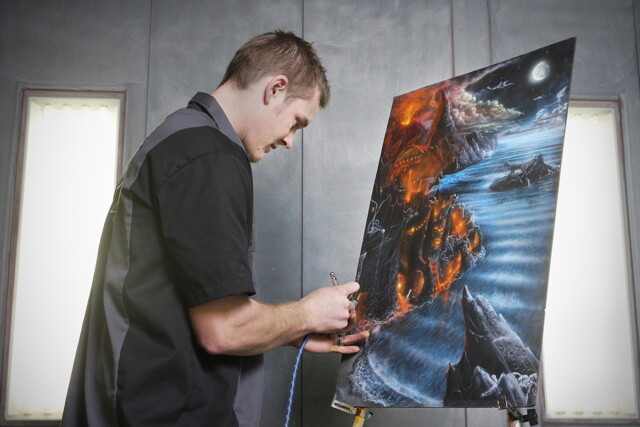 When he's not painting cars, motorcycles, helmets, signs and more, 21-year-old local air brush artist Luke Johnson covers canvases with fantastic landscapes.