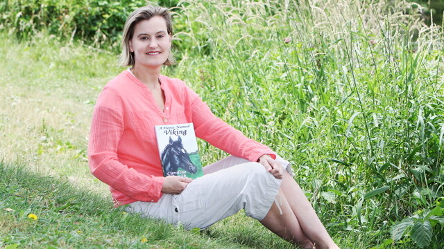 Caroline Akervik drew on her experiences growing up on a horse farm to pen her first book, A Horse Named Viking.