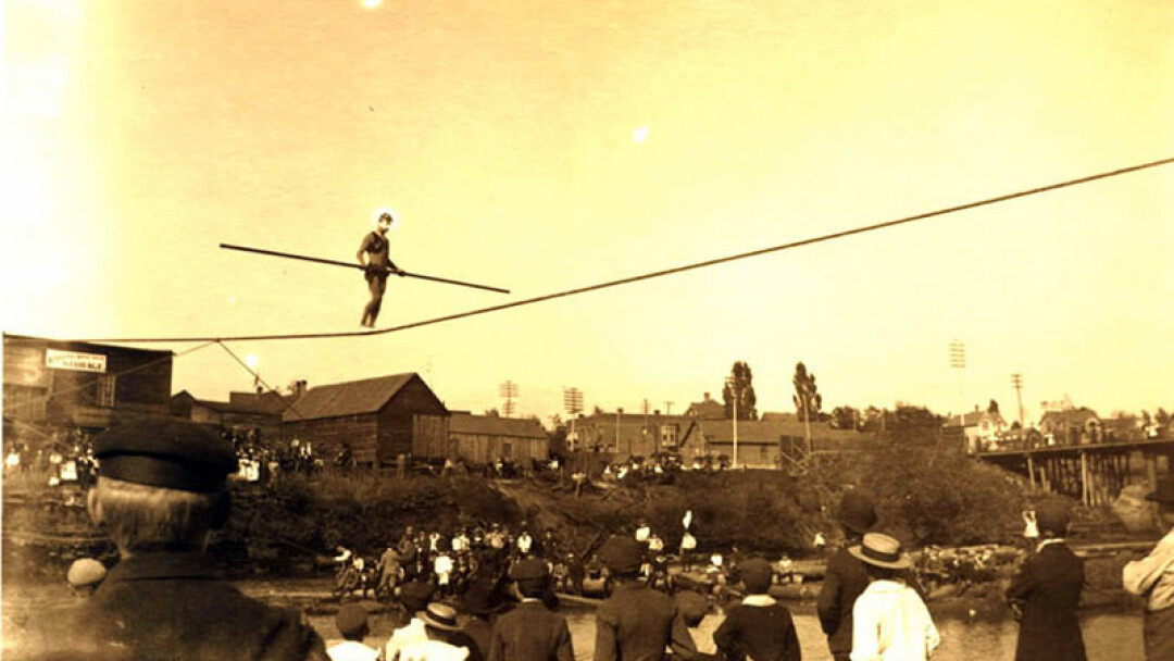 IT'S BEEN DONE! Old-timey river fun – a tight rope walker over the Eau Claire River near downtown EC..