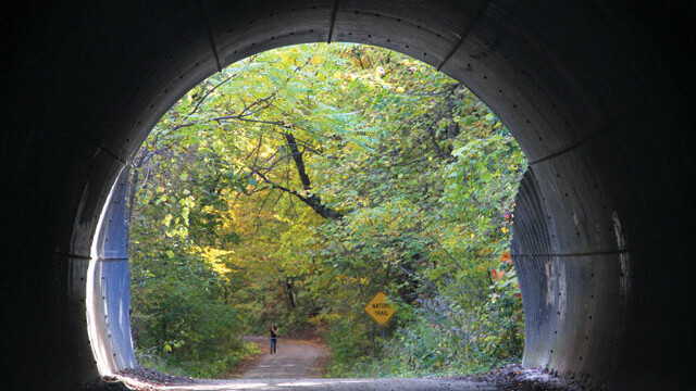 "ENTER IF YOU DARE ... TO SEE SOME GORGEOUS WOODLAND TRAILS, HIDDEN AWAY RIGHT IN THE HEART OF EAU CLAIRE. The ""big tunnel"" under the State Street hill is just one of the wonders you'll witness while walking along the gravely road that is Putnam Trail."