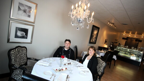 Tony Draganowksi and Katie Borchers Warner at their new catering business and restaurant, Bijou Bistro and Catering. To the right is just a sampling of their dessert menu. Try not to drool, you're in public.