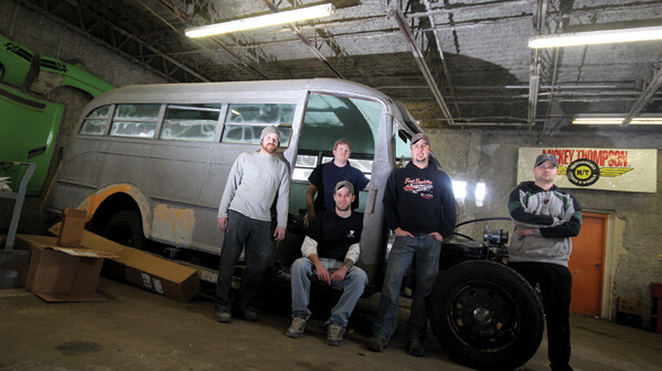 The crew at Fast Freddie's Rod Shop, helmed by Fred Kappus (second from right) pose with the Elk Mound School Bus in its current form.