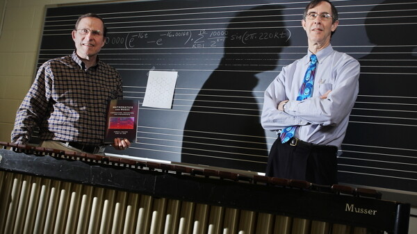 THEY'VE GOT RHOMBOIDS, THEY'VE GOT MUSIC. UW-Eau Claire math professor James Walker, left, and music professor Gary Don collaborated to write a newly published textbook, Mathematics and Music: Composition, Perception, and Performance.