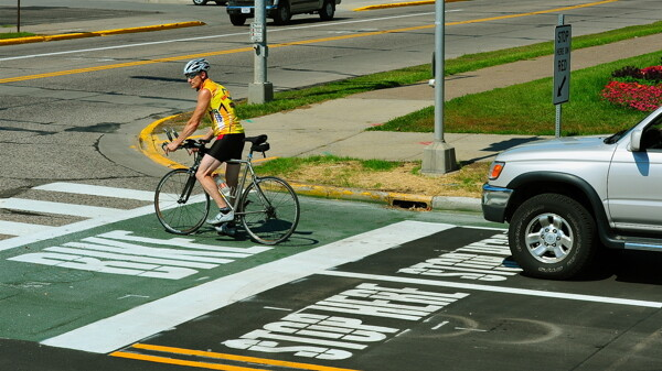 "RIDING WITHIN THE LINES. This ""bike box"" at the intersection of 13th Avenue East and Broadway in Menomonie is designed to make cycling safer."