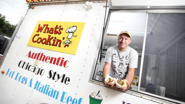 """HEY, GOOD LOOKIN'!"" Curt Simonson's dream of having a restaurant on wheels recently became reality. What's Cookin' serves up Chicago-style hot dogs, Italian beefs, and other classic lunchtime fare at locations throughout Eau Claire."