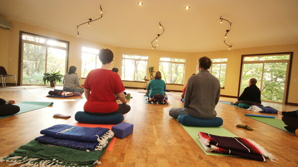 The Center offers space for wellness and creative classes of all sorts, including yoga (held in a new sunroom).