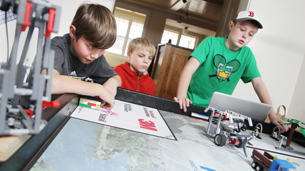 Members of the Eau Claire-based Lego robotics team The Brain Builders watch as their robot tries to grab and drag a truck. Later this month, the elementary-aged team will be competing against middle schoolers at this year's state competition. They'll be graded on the construction of their robot, as well as the character of their team.