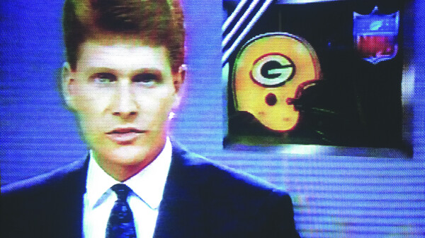 THIS JUST IN: MY HAIR IS PERFECT. Bob Brainerd appears in a WEAU-TV sports broadcast in 1990.