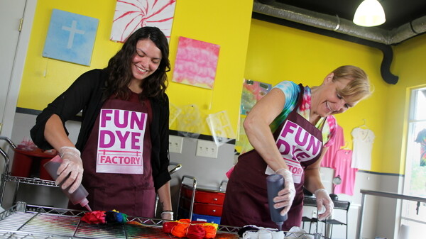 COLORFUL CHARACTERS. Bobbi Potter, right, opened Fun Dye Factory in downtown Eau Claire last year after being inspired by a TV show.