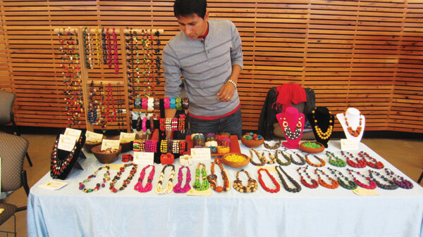 STICK YOUR NECK OUT. Juan Carlos displays his handmade jewelry, made with natural materials from Ecuador.