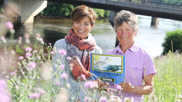 BEAUTIFUL DAY FOR A BOOK ABOUT STORMS. Mary Gladitsh (left) illustrated Karen Wise's (right) children's book, Freebee the Grebe, which stresses the importance of storms to the Earth's environment.