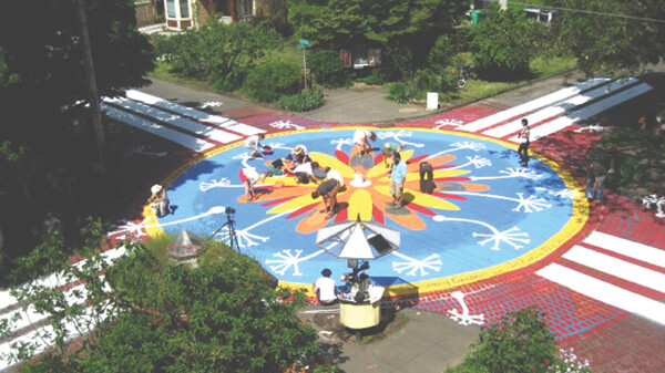 PORTLAND, OF COURSE. Portland, Oregon, has tried similar street murals at several intersections.