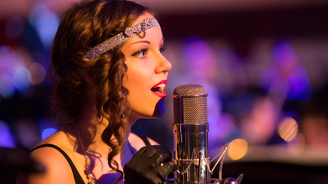 CROON TIME. Brooke Nicole Sjoquist was among the performers on Nov. 14 when Eau Claire Jazz Inc. (in partnership with UW-Eau Claire) presented Gatsby's Gala at the Davies Center. The jazz age-themed dance took cues from The Great Gatsby's portrayal of the Roaring Twenties.
