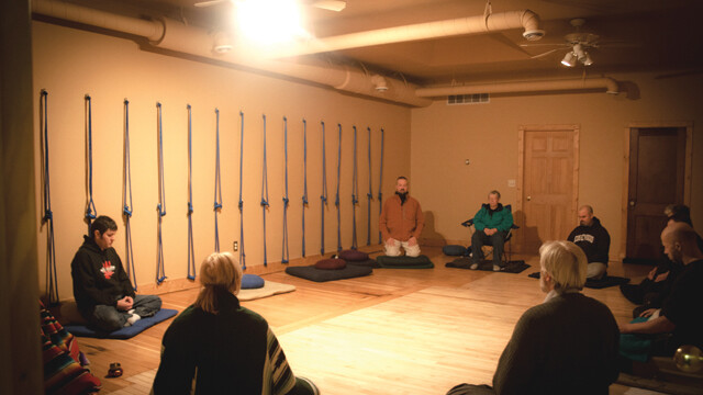 COMMUNAL INSPIRATION. Participants in the Eau Claire Buddhist Sangha, shown here in 2010, meditate together every week at the Yoga Center of Eau Claire.