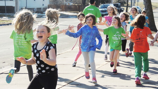 HIGH FIVES ALL AROUND. More than 1,000 third- through fifth-grade girls from local schools have taken part in the Girls on the Run of Eau Claire Country program since its inception in 2006.