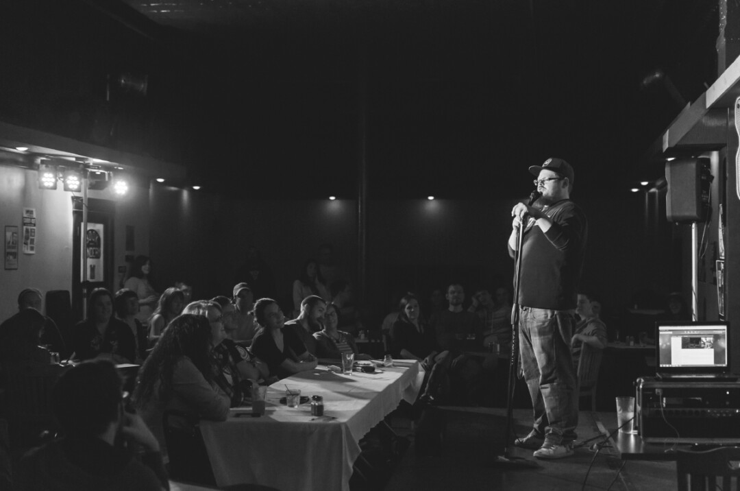 PACKED HOUSE | Local comic Justin Schenck throws his short-n-sweet style of joke writing at a sold-out Thursday crowd, opening for John Conroy, a handpicked touring comic from Washington D.C.