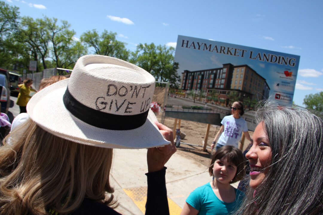HATS OFF TO THE CONFLUENCE. City Councilwoman Catherine Emmanuelle, right, organized a rally of women in support of the Confluence Project May 9.
