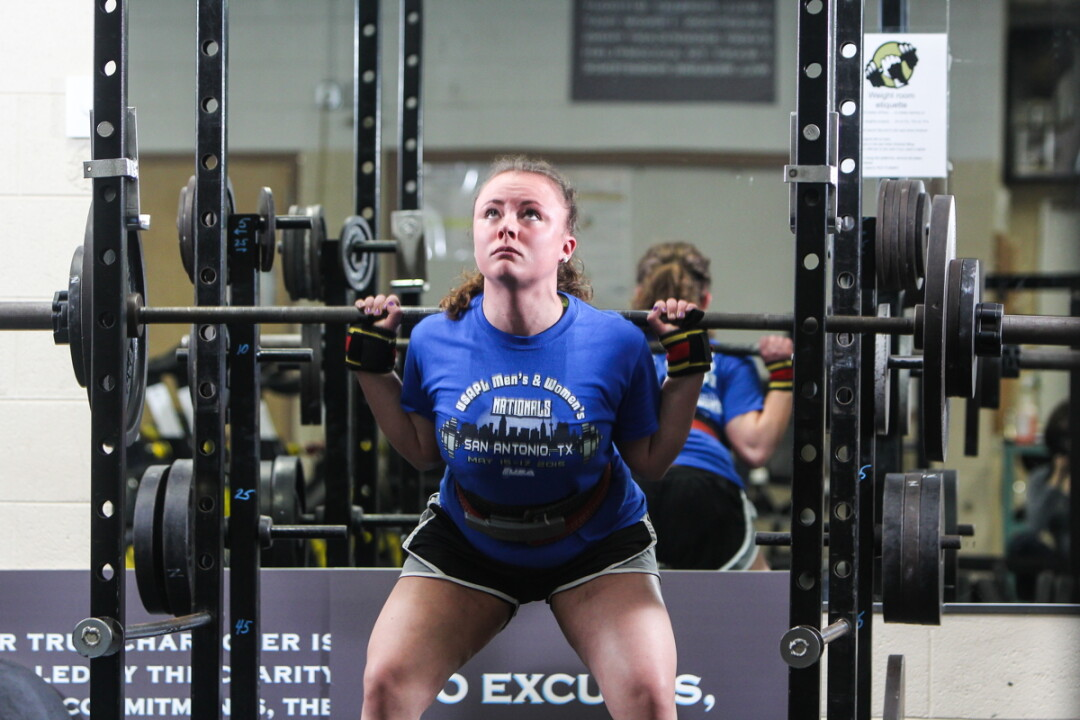 PREMIER POWERLIFTERS. We're not sure exactly how much weight North High School powerlifter Sam Kroll is lifting in these photos, but it's probably a ton. Yeah? Can we agree on a ton? She'll be heading to the World Powerlifting Championships in the Czech Republic with her coach, Mariah Hamm (above, spotting).