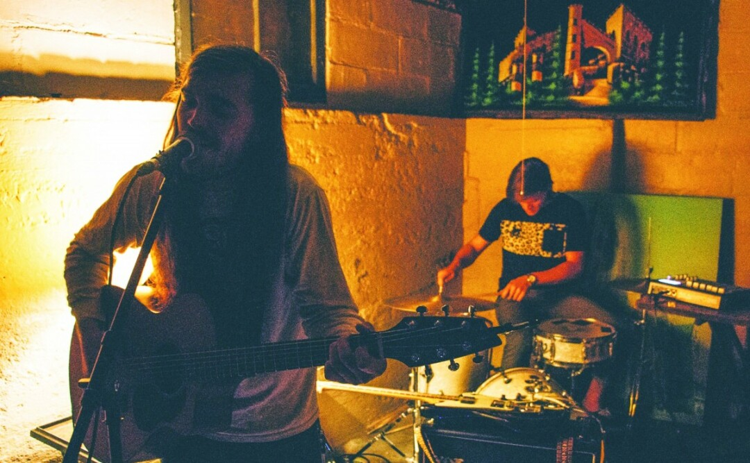 "DOWN BELOW. Gabe Larson performs at the ""Lake House"" basement venue in Eau Claire. Larson, formerly of Reverii, has named his latest project – Waldemar – after his late grandfather."