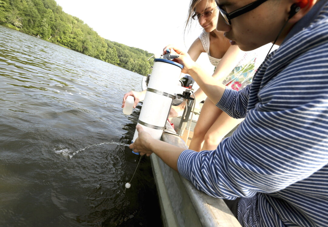 Students take a water sample from  Lake Menomin during the 2014 program.