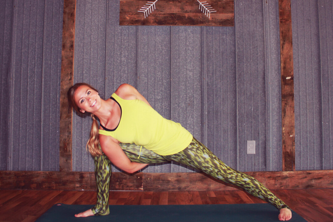 STRETCHY SELFIE. Amy Erickson used a timer to capture a picture of herself inside her new downtown business, Latitude 44 Yoga Studio. The studio's interior, shown at right, features sheet metal and repurposed wood.