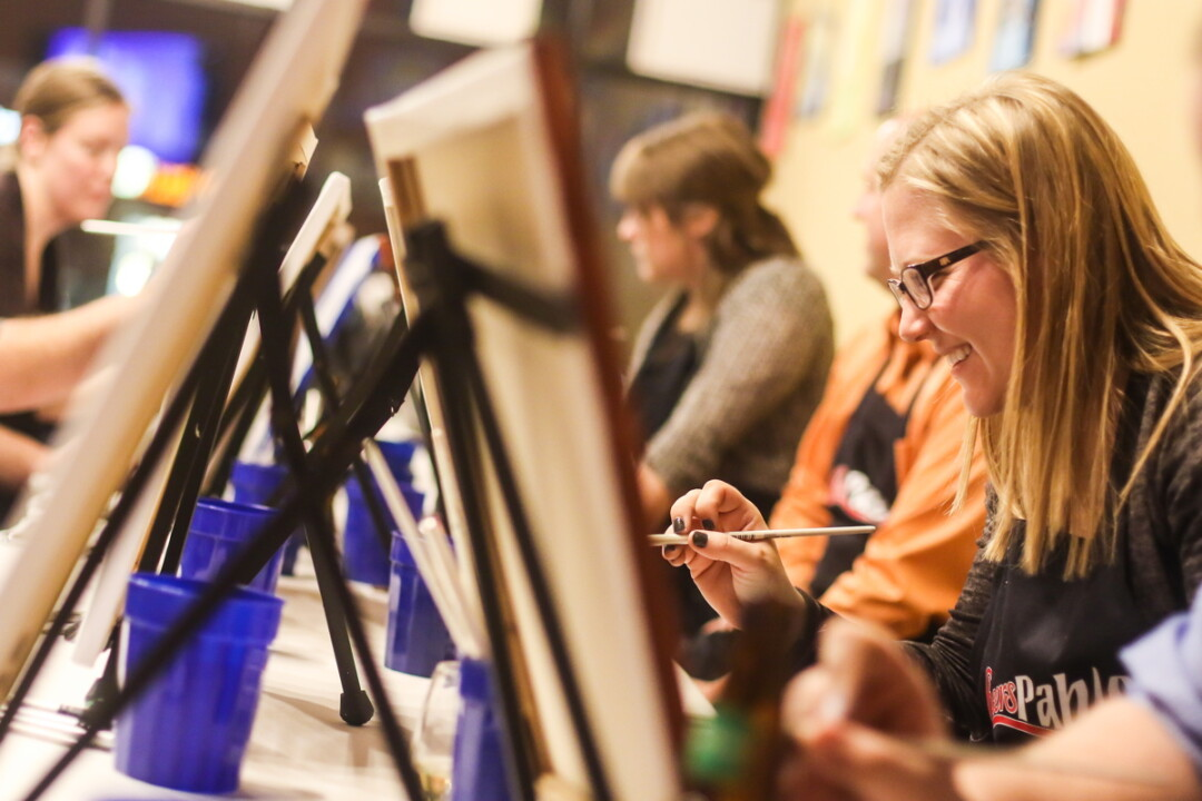 PLEASING TO THE PALETTE. Amateur artists get their paint on at Cheers Pablo in Eau Claire.