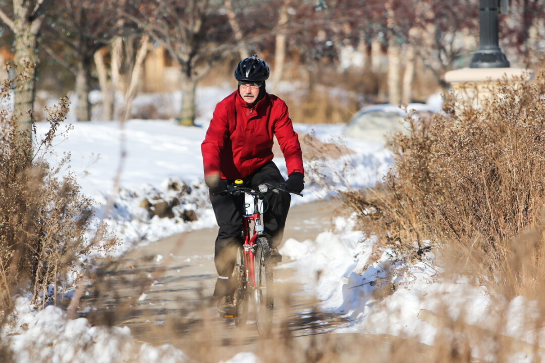 BOB EIERMAN COMMUTES TO HIS JOB AT UWEC ON A BICYCLE YEAR-ROUND – EVEN IN WINTER.