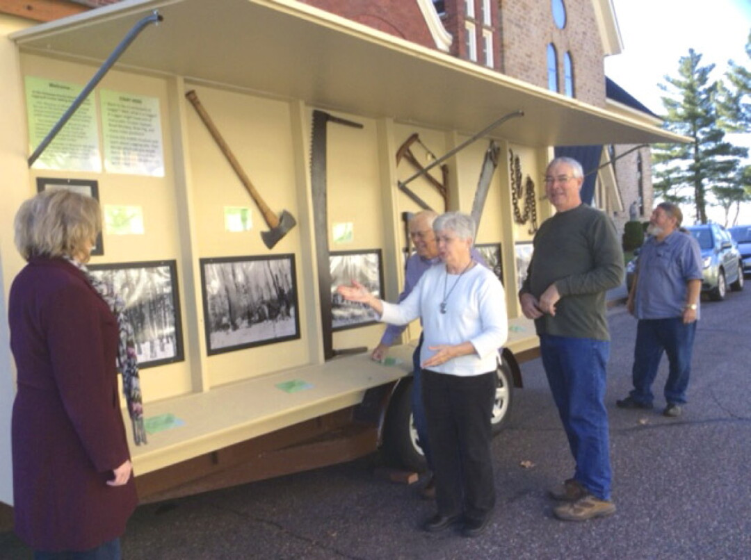 FEEL FREE TO AX QUESTIONS. The Chippewa County Historical Society's new Mobile Lumberjack Museum.