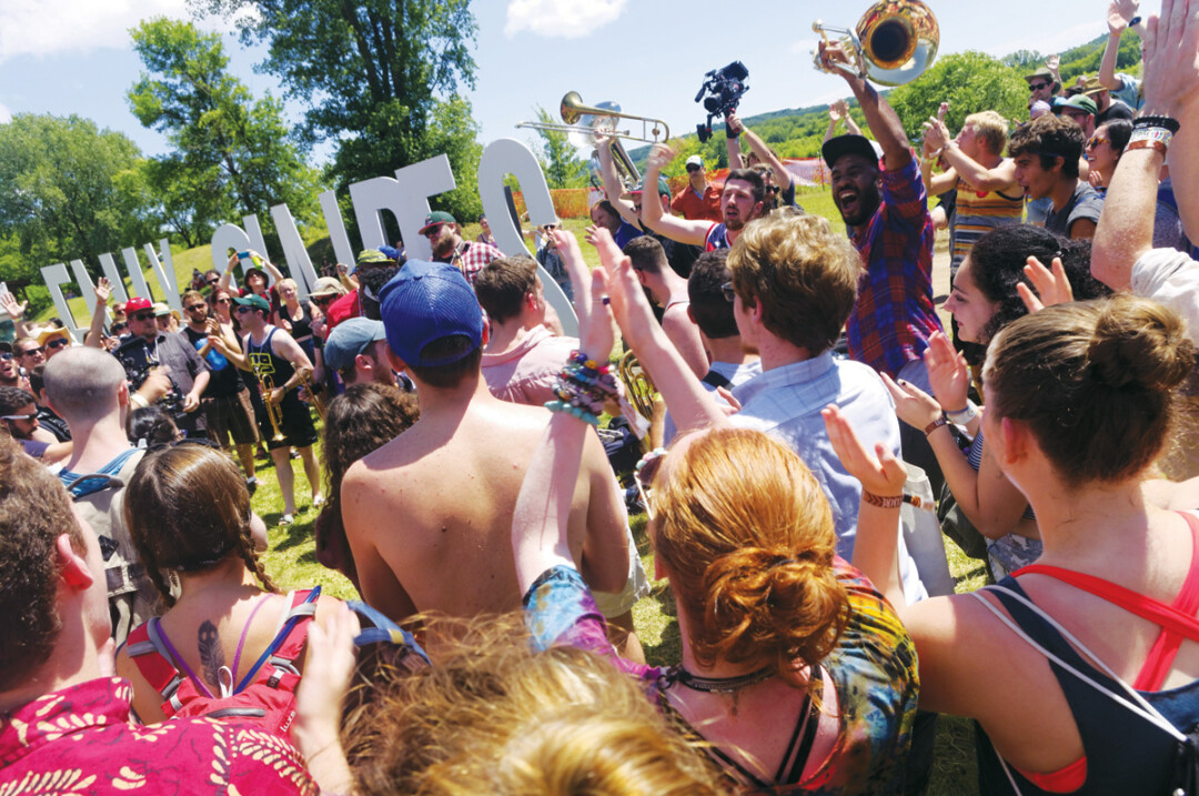 Fans got into the spirit with the no bs! brass band as the band paraded around the grounds at last year's eaux claires music and arts festival.