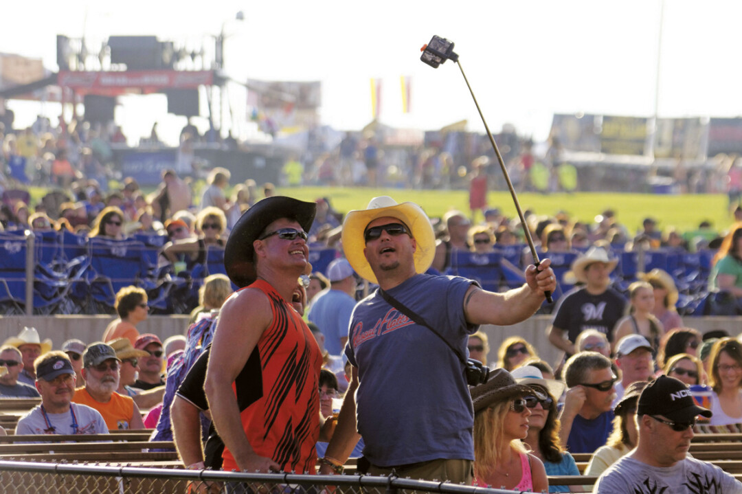 A couple of country fans couldn't resist a selfie at Country Fest last year.