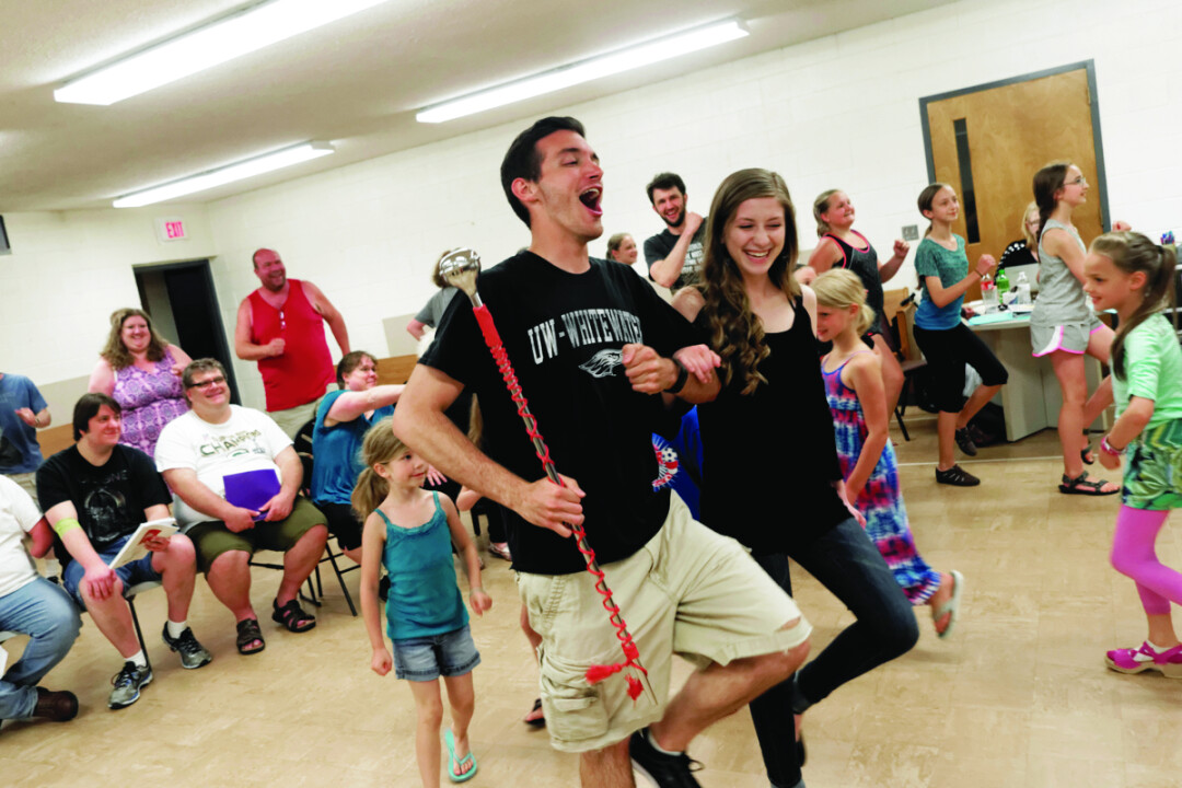 With 110 cornets close at hand! Luke Heidtke (as Harold Hill) and Molly Wilson (as Marion Paroo) leads the parade in rehearsal for The Music Man.