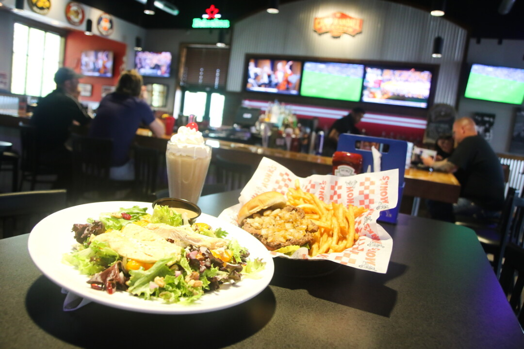 GRILL UP AND FILL UP.  Monk's Bar & Grill opened its fifth location last month – in the former home of Northwoods Brewpub near Oakwood Mall.