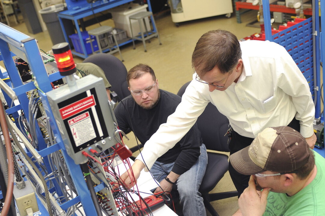 Chippewa Valley Technical College Industrial Mechanic instructor Tim Tewalt, center, works with students on troubleshooting automation equipment in the program lab at CVTC's Manufacturing Education Center in 2015. A federal grant announced June 27 will enable CVTC to expand the program.
