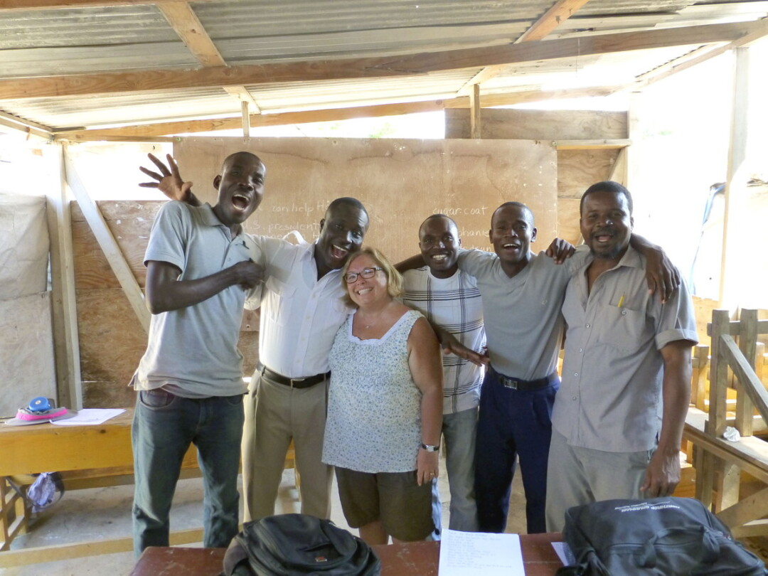 ALL SMILES. Bonni Knight, center, with teachers at the English in Mind Institute in Port-au-Prince, Haiti. Knight is organizing fundraisers for the school at the end of the month.