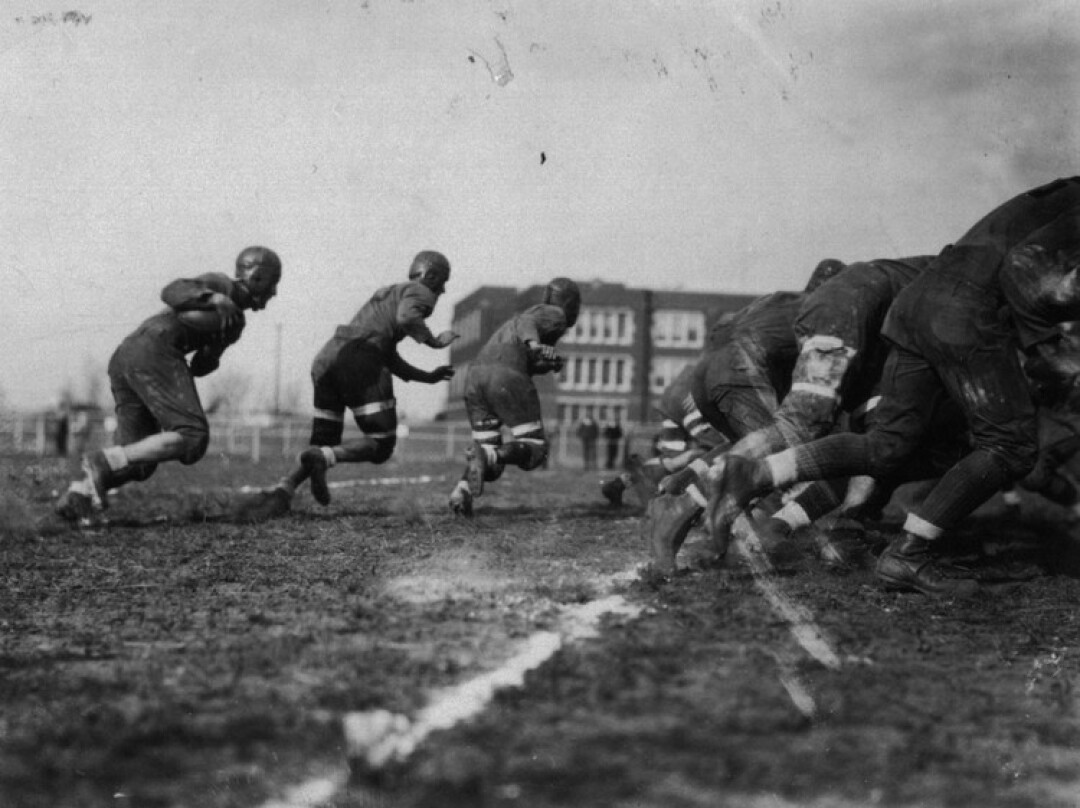 A scene from the 1929 Homecoming Football Game against Stevens Point.  Schofield Hall can be seen in the background.