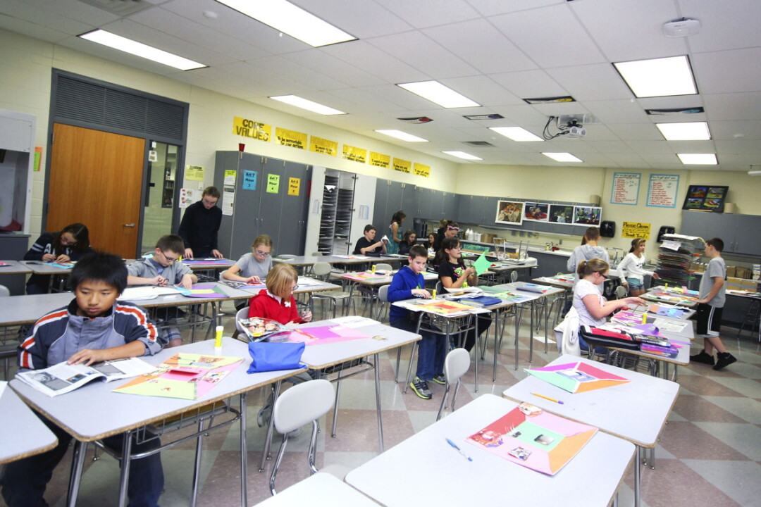 PUTTING THE 'FUN' IN 'FUNDING.' Students in an art class at