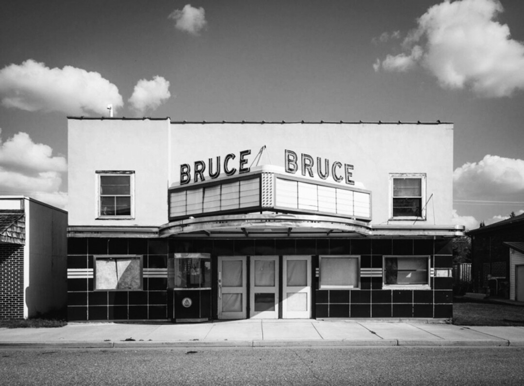 In one of his latest projects, prolific photographer Travis Dewitz is profiling towns up and down the Chippewa River. Above: An abandoned theater in Bruce, Wisconsin.