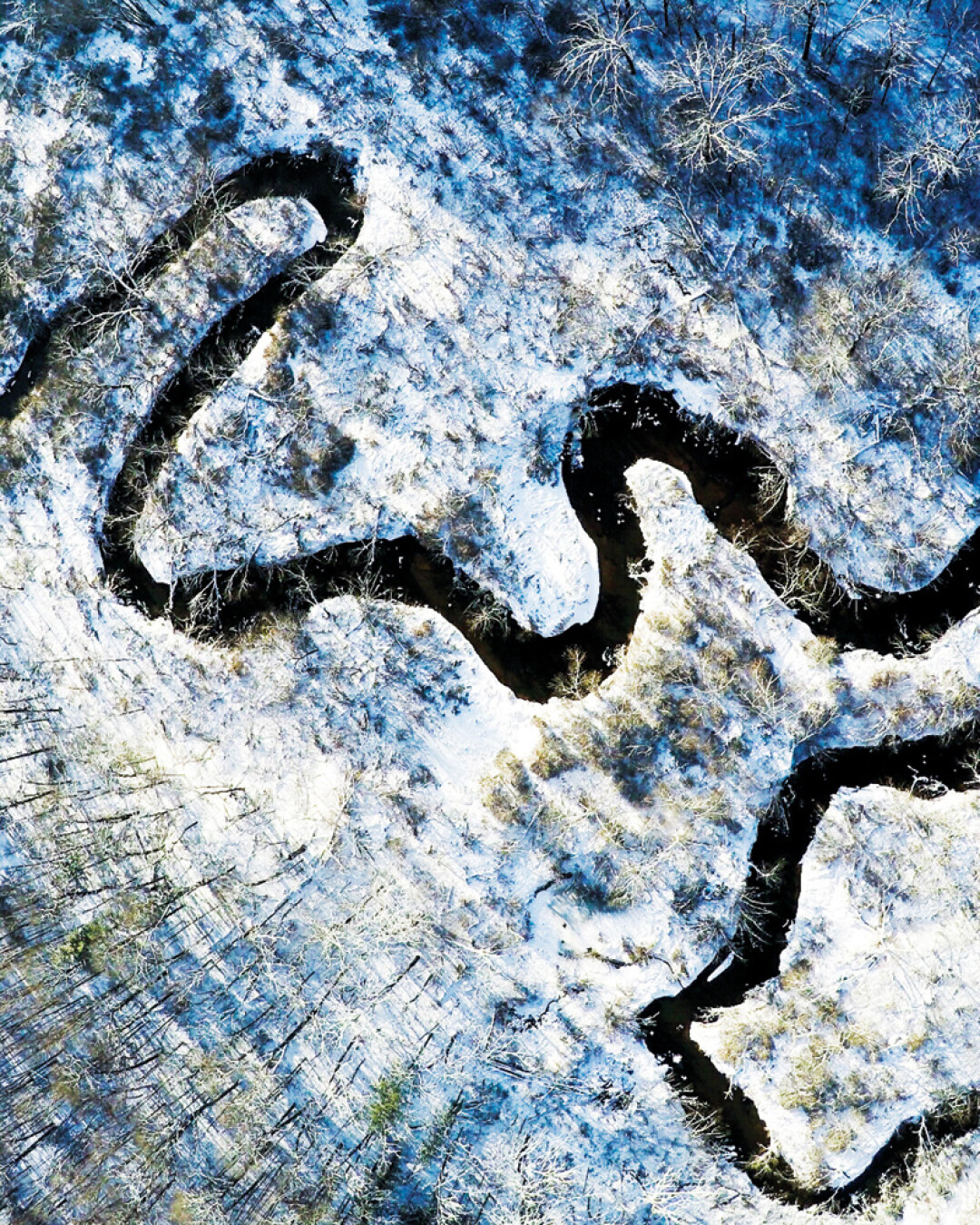 "A RIVER TWISTS THROUGH IT. Part of his ""Frosty Mini Series,"" photographer Nick Uthe wanted to show Wisconsin from a new perspective, using a drone to capture some local landscape at Lowes Creek County Park, shown here. Uthe says, ""This was a small tribute to the state I love."" Instagram: @nickuthe"