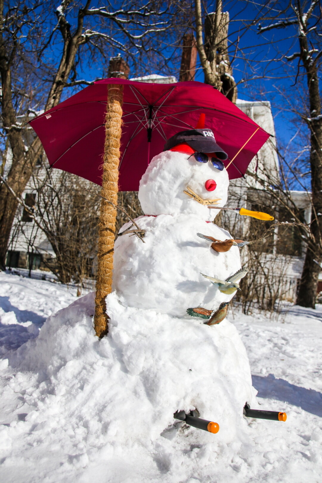 MADE IN THE SHADE. If the sun hasn't been too cruel, you'll still be able to find this delightful snowman on North Dewey Street in Eau Claire. Unexpected additions such as an umbrella and a small flock of birds really ramp up the whimsy on this guy.