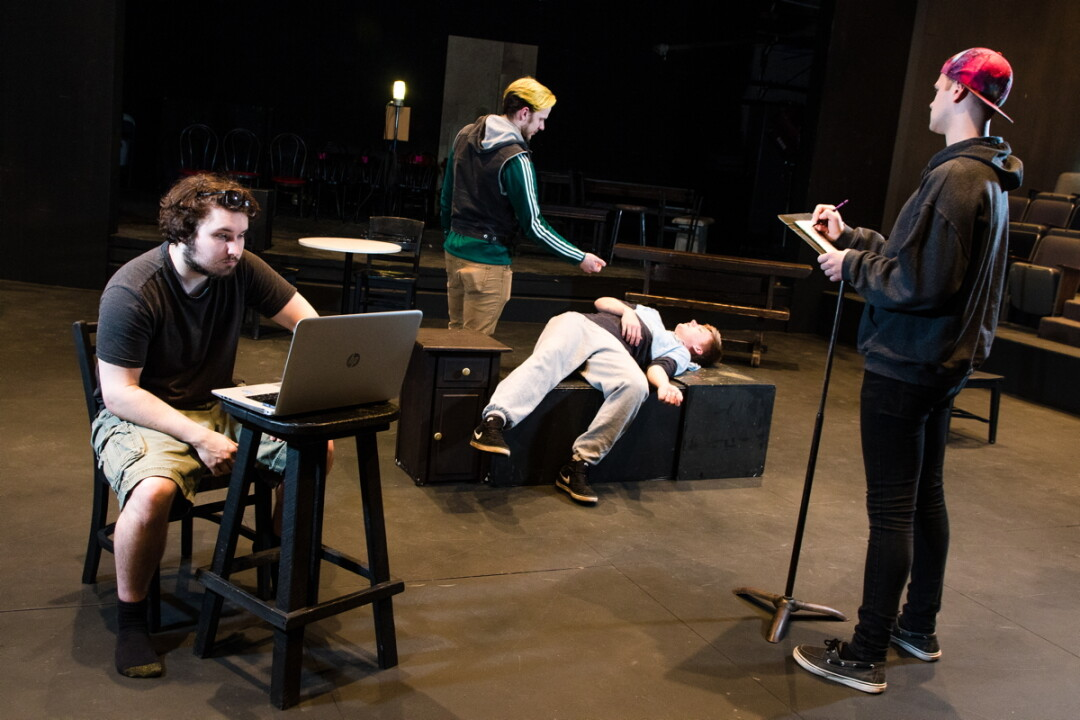 UWEC students (left to right) Zach Staads, Mitchell Marten, Darby Hand, and Barry Inman rehearse a new, original theatrical work.