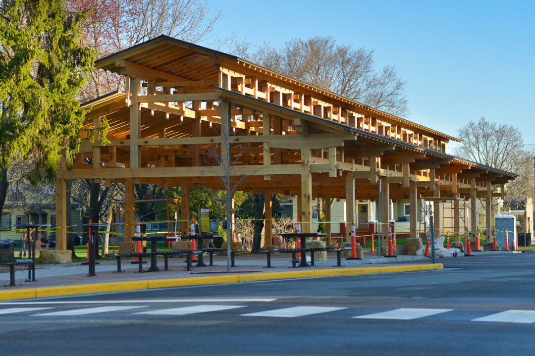 Wallace headed up the new timber frame pavilion project (right) for the Menomonie Farmers Market. Image: Timothy Mather