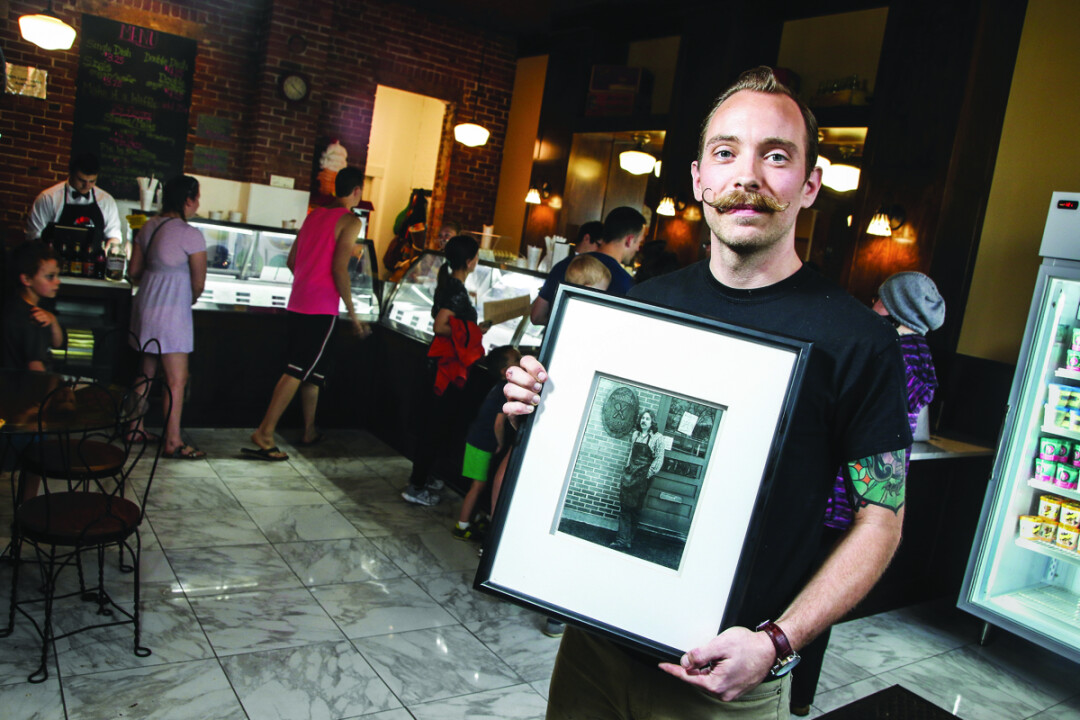 "TASTES GOOD, FEELS GOOD. Ramone's Ice Cream Parlor co-owner Blayne Midthun holds a picture of his father, Kevin ""Ramone"" Midthun, whose kindness and humility helped to inspire the new shop."