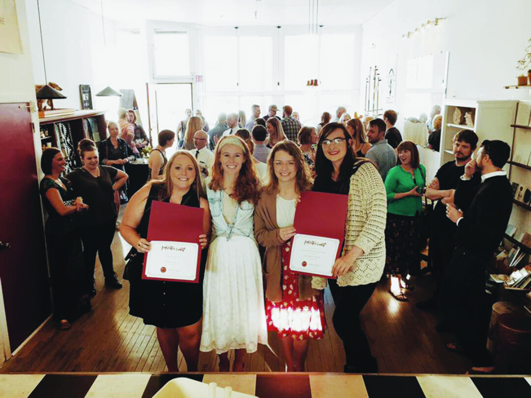 WISHES GRANTED. Becca Cooke (center left), owner of Red's Mercantile and facilitator of the Red Letter Grant, presents the spring 2017 winners, Melnaturel LLC (left) and Odd Brand Strategy (right). Each startup was awarded $2,000.