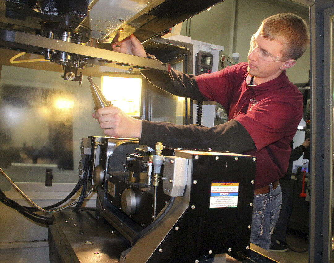 A Chippewa Valley Technical College student operates a computer numerical controlled (CNC) lathe.