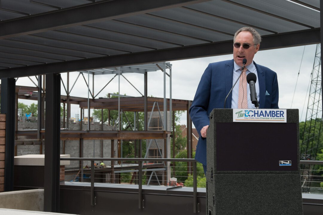 MOVING ON UP. Work continued on the Confluence Arts Center in the background as Kevin Miller was introduced as the center's executive director.