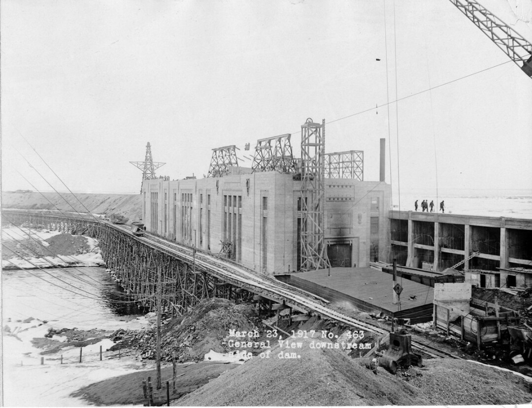 TAKE ON A LAKE. A newly published book features images like the one above, showing the Lake Wissota dam under construction in 1917. The book was authored by (left to right) Donna Bourget, Jim Schuh, and Anne Keller, shown during a visit to the dam.